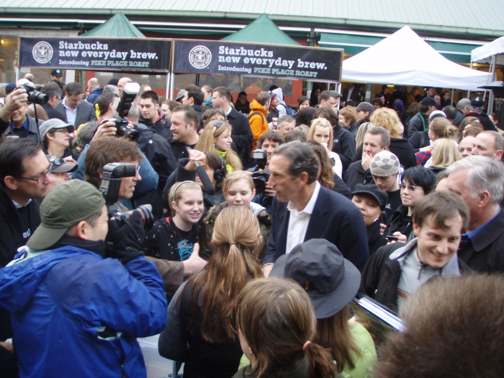 This is me in the crowd at Pike Place Market in 2008, on the day that Starbucks introduced its Pike Place Roast. CEO Howard Schultz is signing autographs in the foreground.