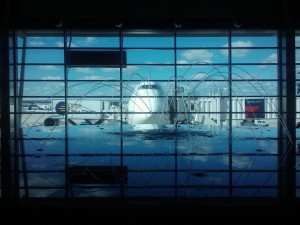 Photo from inside Detroit Airport, showing a fountain and a 747 airplane.