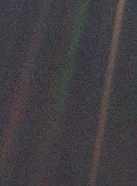 Original caption written by Nasa: This narrow-angle color image of the Earth, dubbed 'Pale Blue Dot', is a part of the first ever 'portrait' of the solar system taken by Voyager 1. The spacecraft acquired a total of 60 frames for a mosaic of the solar system from a distance of more than 4 billion miles from Earth and about 32 degrees above the ecliptic. From Voyager's great distance Earth is a mere point of light, less than the size of a picture element even in the narrow-angle camera. Earth was a crescent only 0.12 pixel in size. Coincidentally, Earth lies right in the center of one of the scattered light rays resulting from taking the image so close to the sun. This blown-up image of the Earth was taken through three color filters -- violet, blue and green -- and recombined to produce the color image. The background features in the image are artifacts resulting from the magnification.
